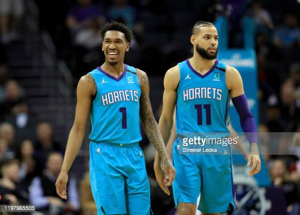 Teammates Malik Monk and Cody Martin of the Charlotte Hornets react after a play against the Indiana Pacers during their game at Spectrum Center on...