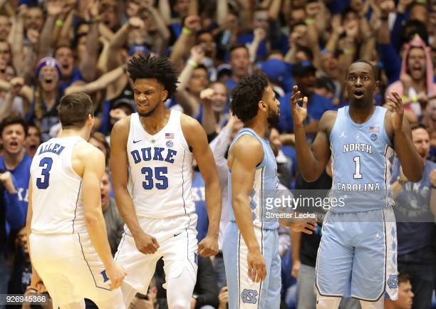 Teammates Marvin Bagley III and Grayson Allen of the Duke Blue Devils react after a play against teammates Joel Berry II and Theo Pinson of the North...