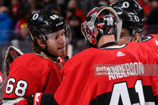 Teammates Mike Hoffman and Craig Anderson of the Ottawa Senators celebrate after their win against the New York Rangers at Canadian Tire Centre on...