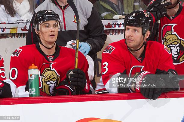 Teammates Mike Lundin and Marc Methot of the Ottawa Senators xlook on from the bench during an NHL game against the Carolina Hurricanes at Scotiabank...