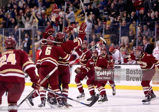 Teammates mob Alex Tuch of Boston College after he scored a game winning goal in overtime to defeat Boston University in the Beanpot Tournament...