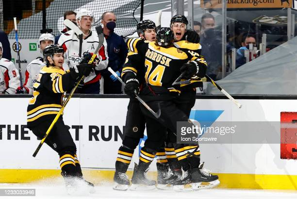 Teammates mob Boston Bruins center Charlie Coyle after his goal made it 3-0 during Game 4 of the NHL Stanley Cup Playoffs First Round between the...
