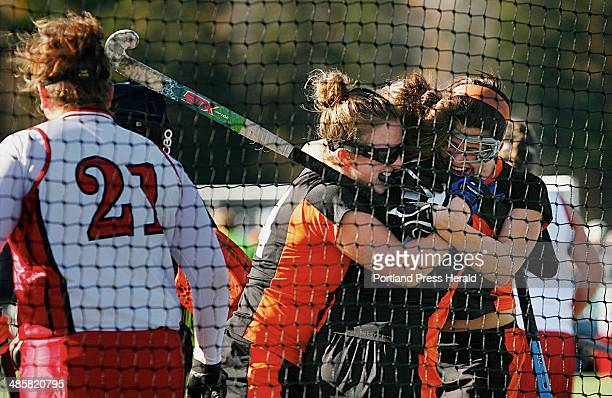 NYA teammates Nicole Fuller left Kylie Dalbec and Katherine Millett celebrate a goal during the Class C field hockey championships at Hampden Academy...