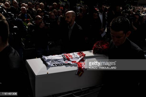 TOPSHOT Teammates of Belgian cyclist Bjorg Lambrecht carry his coffin prior to his funeral ceremony on August 13 2019 in Knesselare Lotto Soudal...