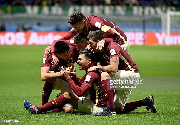 Teammates of Club America celebrate the socond goal of forward Silvio Romero during the Club World Cup football match between Jeonbuk Hyundai and...