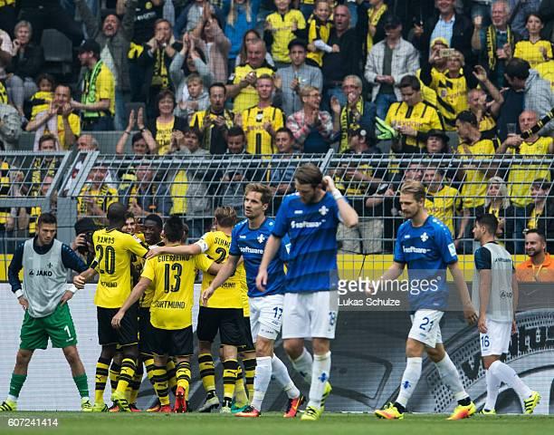 Teammates of Dortmund celebrate the 30 goal of Christian Pulisic of Dortmund during the Bundesliga match between Borussia Dortmund and SV Darmstadt...