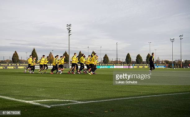 Teammates of Dortmund warm up during a training session ahead of their Champions League match against Sporting CP at Dortmund Brackel Training Ground...