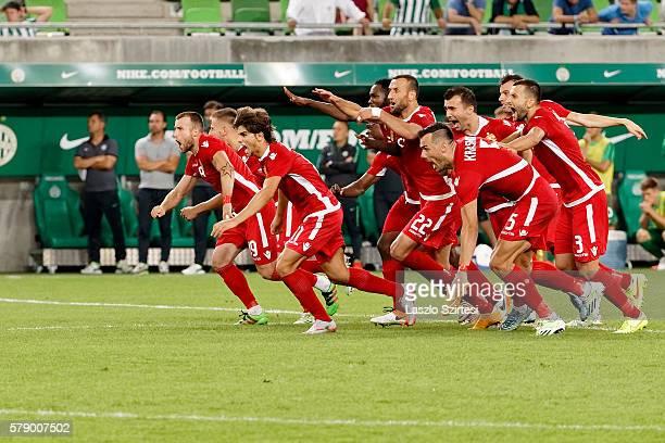 Teammates of FK Partizani Lorenc Trashi Jurgen Bardhi Labinot Ibrahimi Gezim Krasniqi Renato Arapi celebrate the winning of the penalty shootout...