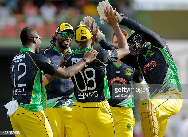 Teammates of Jamaica Tallawahs celebrate with Dave Bernard Jr the dismissal of Raymon Reifer of Barbados Tridents during a match between Barbados...