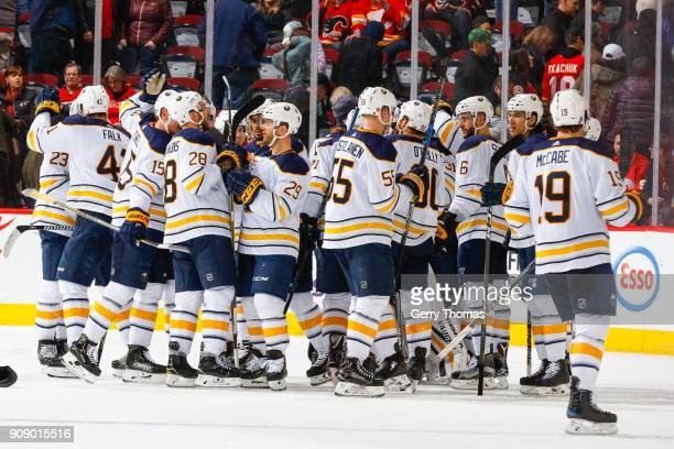 Teammates of the Buffalo Sabres celebrate after winning an NHL game against the Calgary Flames on January 22 2018 at the Scotiabank Saddledome in...