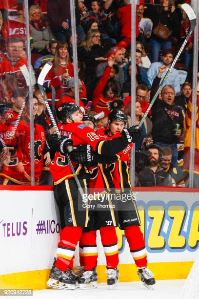 Teammates of the Calgary Flames celebrate in an NHL game on February 19 2018 at the Scotiabank Saddledome in Calgary Alberta Canada