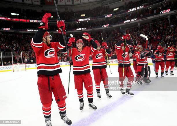 Teammates of the Carolina Hurricanes celebrate a victory wth a Storm Surge during an NHL game against the Calgary Flames on October 29 2019 at PNC...