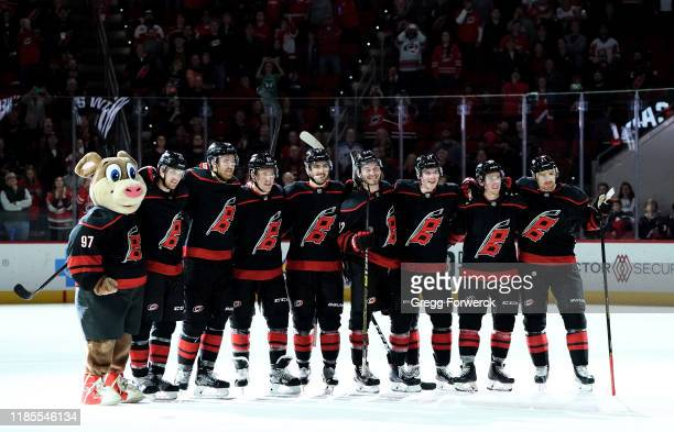 Teammates of the Carolina Hurricanes prepare for a Storm Surge following an NHL game against the Detroit Red Wings on November 1 2019 at PNC Arena in...