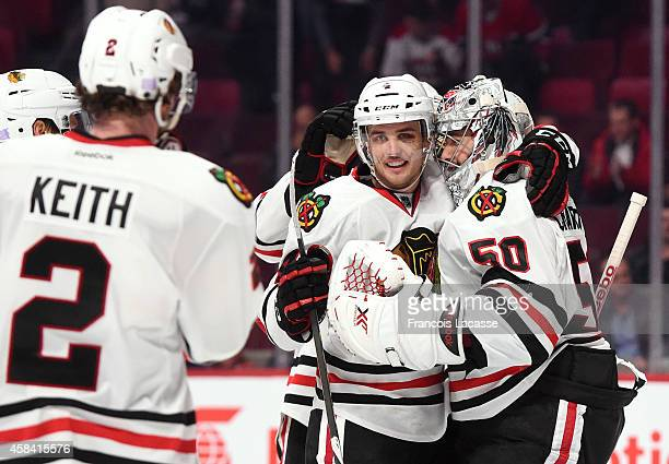 Teammates of the Chicago Blackhawks celebrate the victory against the Montreal Canadiens in the NHL game at the Bell Centre on November 4, 2014 in...