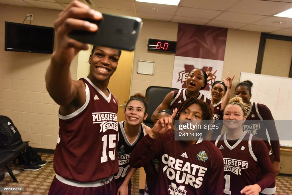 Teammates of the Mississippi State Lady Bulldogs take a selfie in the locker room following their victory of the University of Connecticut Huskies during the 2017 NCAA Women's Final Four at American Airlines Center on March 31, 2017 in Dallas, Texas.