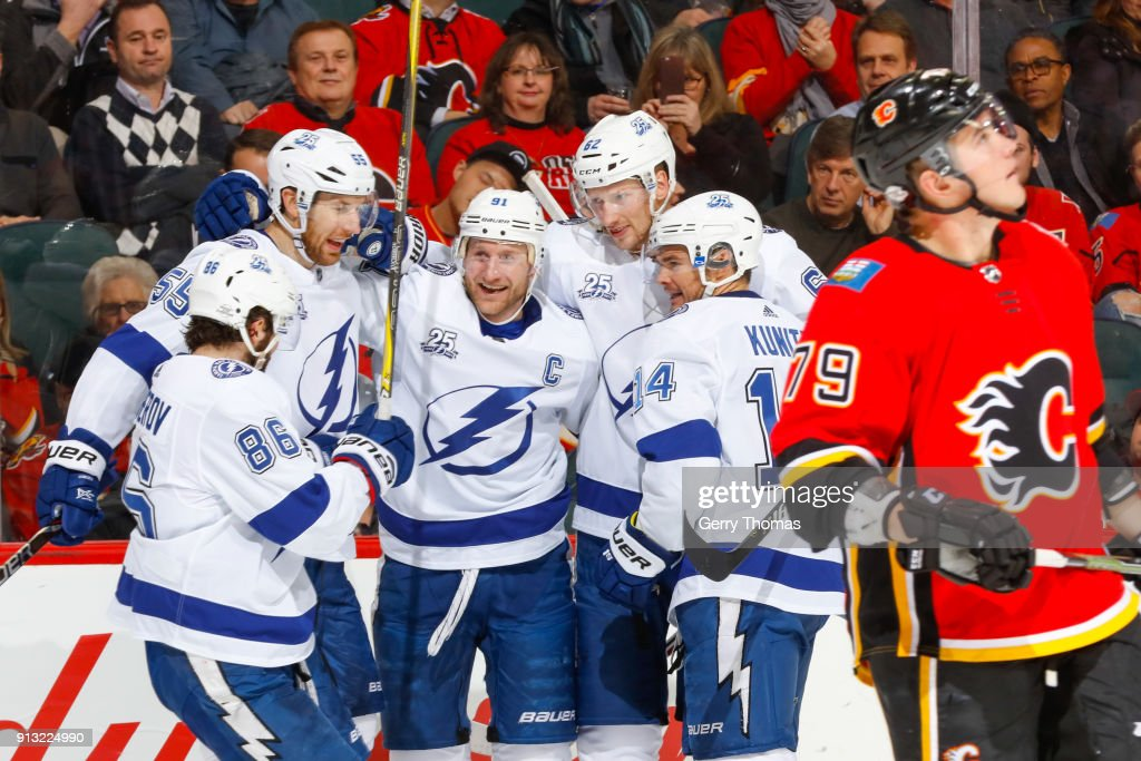 Teammates of the Tampa Bay Lightning celebrate in an NHL game on February 1, 2018 at the Scotiabank Saddledome in Calgary, Alberta, Canada.