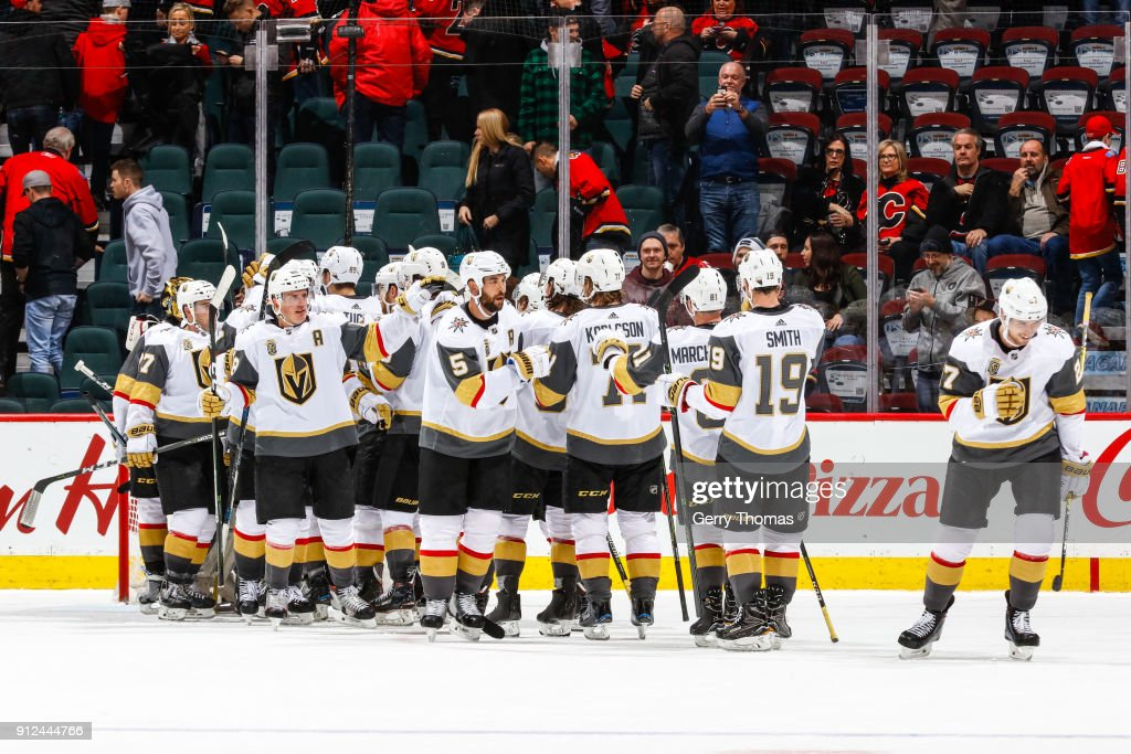 Teammates of the Vegas Golden Knights celebrate after winning in an NHL game on January 30, 2018 at the Scotiabank Saddledome in Calgary, Alberta, Canada.