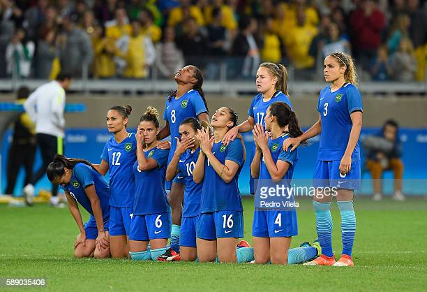 Teammates on Brazil stand together as Penalties Shootout takes place during the Women's Football Quarterfinal against Australia match at Mineirao...