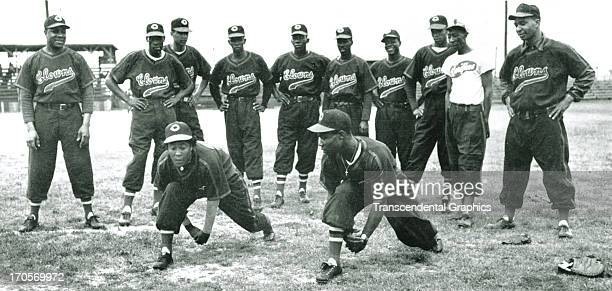 Teammates on the Indianapolis Clowns of the National Negro Leagues work out in a photograph around 1950 in Indianapolis Indiana