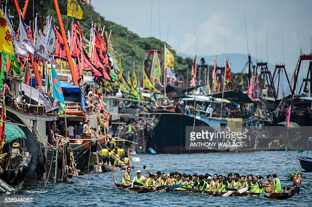 TOPSHOT Teammates paddle as they compete in dragon boat races held to celebrate the Tuen Ng festival in Hong Kong on June 9 2016 / AFP / ANTHONY...