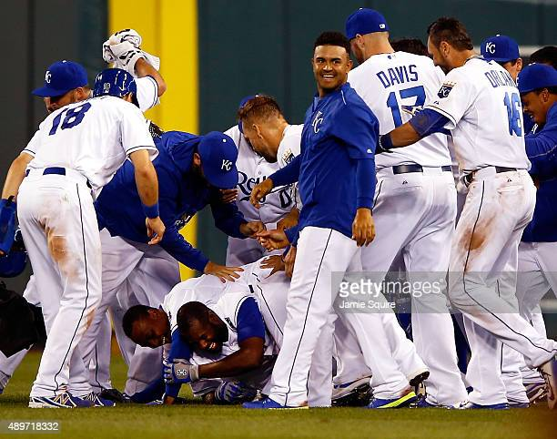 Teammates pile on Lorenzo Cain of the Kansas City Royals after Cain hit the gamewinning RBI to score Paulo Orlando during the 10th inning of the game...