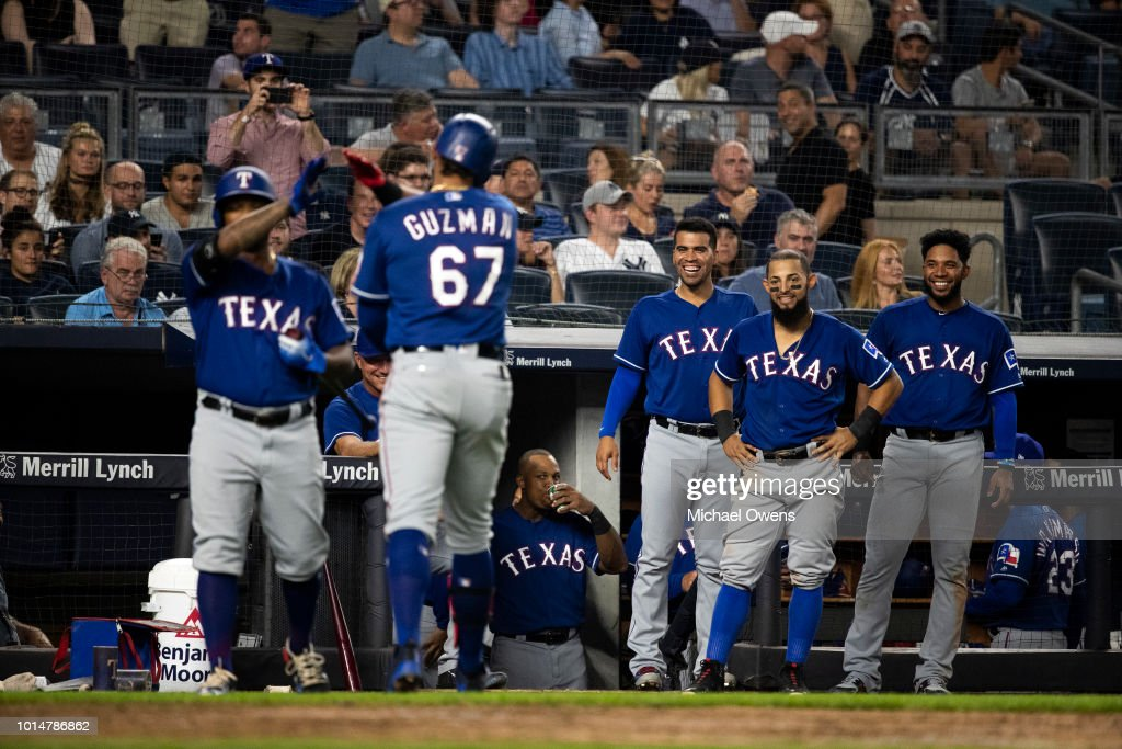 Teammates react to Ronald Guzman #67 of the Texas Rangers third homerun of the night at the top of the seventh inning against the New York Yankees during their game at Yankee Stadium on August 10, 2018 in New York City.