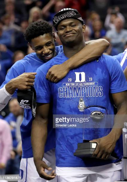 Teammates RJ Barrett and game MVP Zion Williamson of the Duke Blue Devils react after defeating the Florida State Seminoles 7363 in the championship...