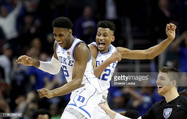 Teammates RJ Barrett and Javin DeLaurier of the Duke Blue Devils celebrate their 7363 victory over the Florida State Seminoles in the championship...