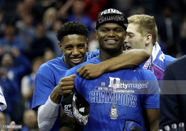 Teammates RJ Barrett and Zion Williamson of the Duke Blue Devils react after defeating the Florida State Seminoles 73-63 in the championship game of...