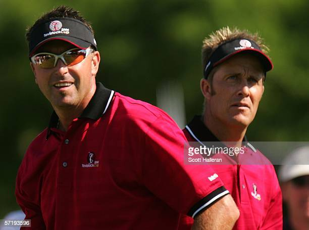 Teammates Robert Allenby and Stuart Appleby of Australia wait on the 12th hole during the first day of the Tavistock Cup on March 27 2006 at the...