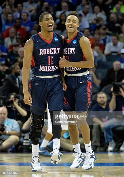 Teammates Rodney Pryor and Marcquise Reed of the Robert Morris Colonials react against the Duke Blue Devils during the second round of the 2015 NCAA...