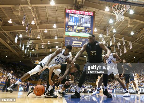 Teammates Rozelle Nix and Cameron Johnson of the Pittsburgh Panthers battle for a loose ball against Amile Jefferson of the Duke Blue Devils during...