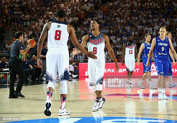 Teammates Rudy Gay and Derrick Rose of the USA Basketball Men's National Team highfive during a game against the Finland Basketball Men's National...