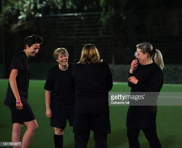 teammates smile and laugh together - showus stock pictures, royalty-free photos & images