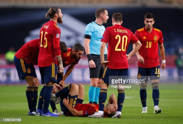 Teammates stand around injured Sergio Canales of Spain during the UEFA Nations League group stage match between Spain and Germany at Estadio de La...