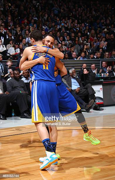 Teammates Stephen Curry and Klay Thompson of the Golden State Warriors hug during the Foot Locker Three Point Contest on State Farm AllStar Saturday...