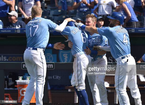 Teammates surround Kansas City Royals center fielder Billy Hamilton after he scored the game winning run during a MLB game between the New York...