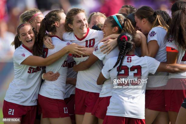 Teammates surround Tierna Davidson of Stanford University to celebrate their victory over UCLA during the Division I Women's Soccer Championship held...
