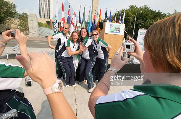 Teammates take photos of Joy Neville Jean Lonergan Rosie Foley and Amanda Greensmith of The Irish Women's Rugby Football Union with the Rugby World...