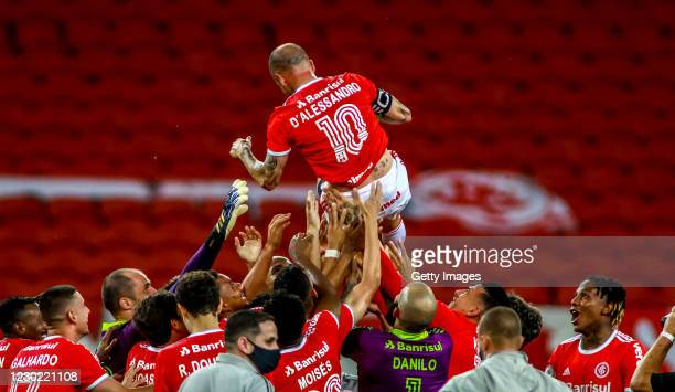 Teammates throw Andrés D'Alessandro Of Internacional after his last match in the club against Palmeiras as part of Brasileirao Series A 2020 at Beira...