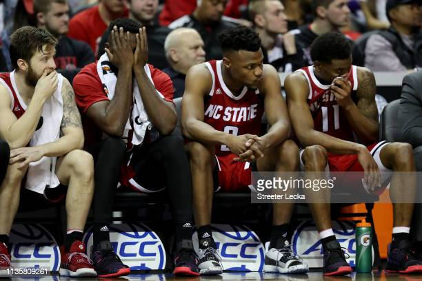Teammates Torin Dorn and Markell Johnson of the North Carolina State Wolfpack react to their 7656 loss against the Virginia Cavaliers in the...