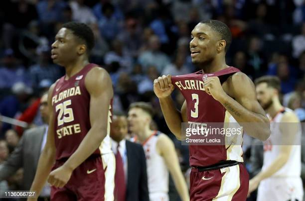 Teammates Trent Forrest and Mfiondu Kabengele of the Florida State Seminoles react after defeating the Virginia Cavaliers 6959 in the semifinals of...