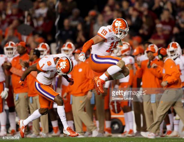 Teammates Trevion Thompson and Tanner Muse of the Clemson Tigers react after a play against the South Carolina Gamecocks during their game at...