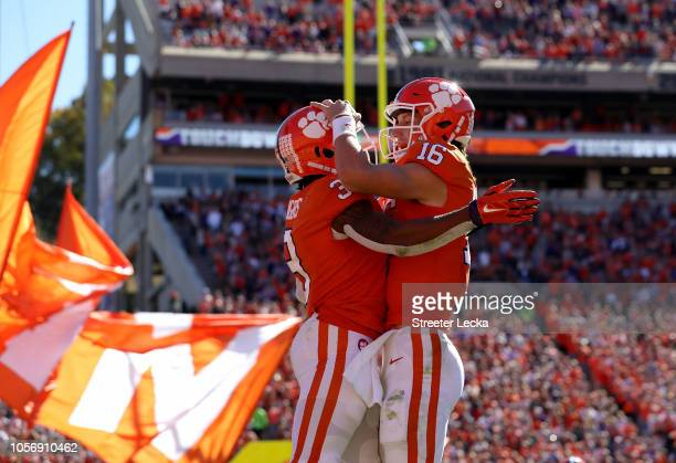 Teammates Trevor Lawrence and Amari Rodgers of the Clemson Tigers celebrate after a touchdown against the Louisville Cardinals during their game at...
