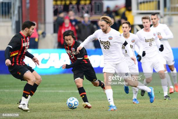 Teammates Tsubasa Endoh and Jake Pace of the University of Maryland battle for control of the ball against Grant Van De Casteele of the University of...