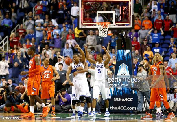 Teammates Tyler Thornton Rasheed Sulaimon and Rodney Hood of the Duke Blue Devils celebrate after defeating the Clemson Tigers 6362 during the...