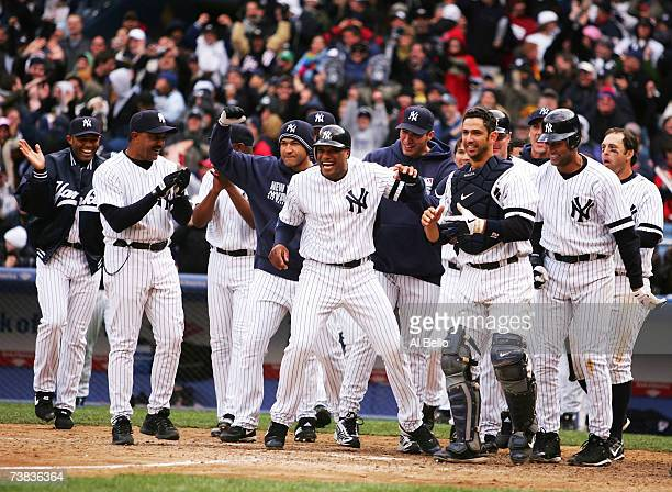 Teammates wait for Alex Rodriguez of the New York Yankees after he hit a game winning grand slam in the bottom of the ninth inning against the...