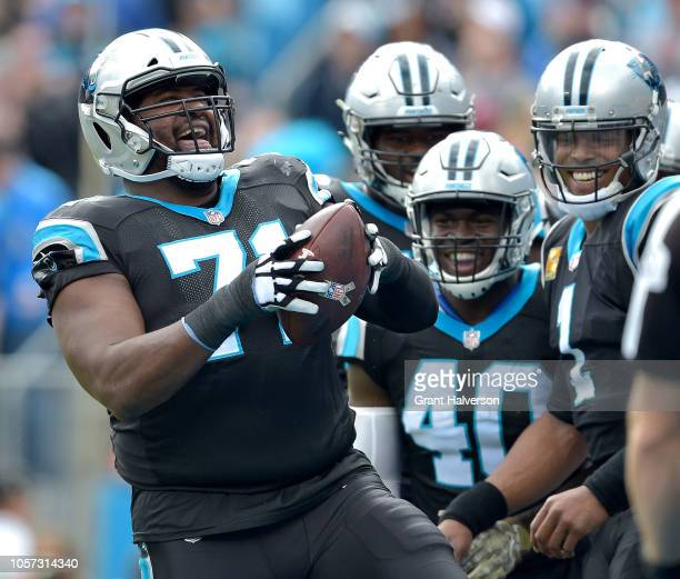 Teammates watch as Marshall Newhouse of the Carolina Panthers prepares to spike the football after a touchdown against the Tampa Bay Buccaneers...