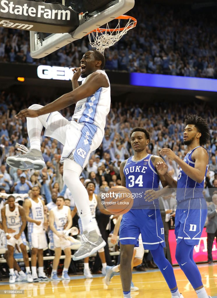 Teammates Wendell Carter Jr #34 and Marvin Bagley III #35 of the Duke Blue Devils watch as Theo Pinson #1 of the North Carolina Tar Heels reacts after a dunk during their game at Dean Smith Center on February 8, 2018 in Chapel Hill, North Carolina.