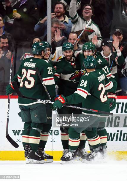 Teammates wish a happy birthday and congratulate Minnesota Wild Winger Daniel Winnik on his 2nd period goal during a NHL game between the Minnesota...
